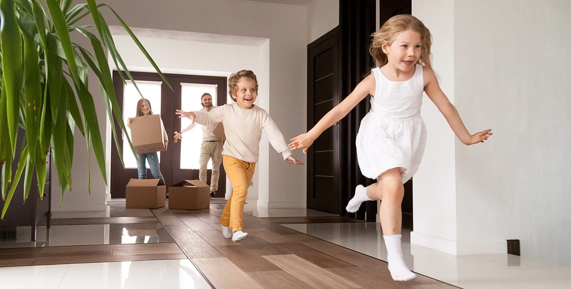Family running into their new dream home- best charlotte home loans