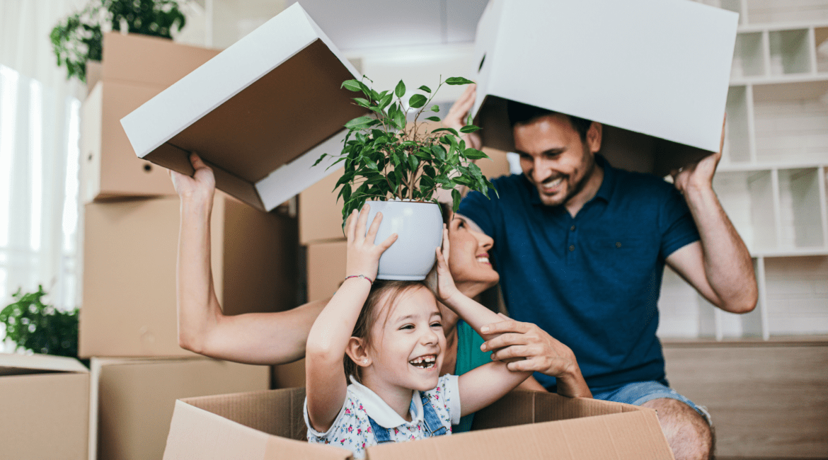 family playing with moving boxes