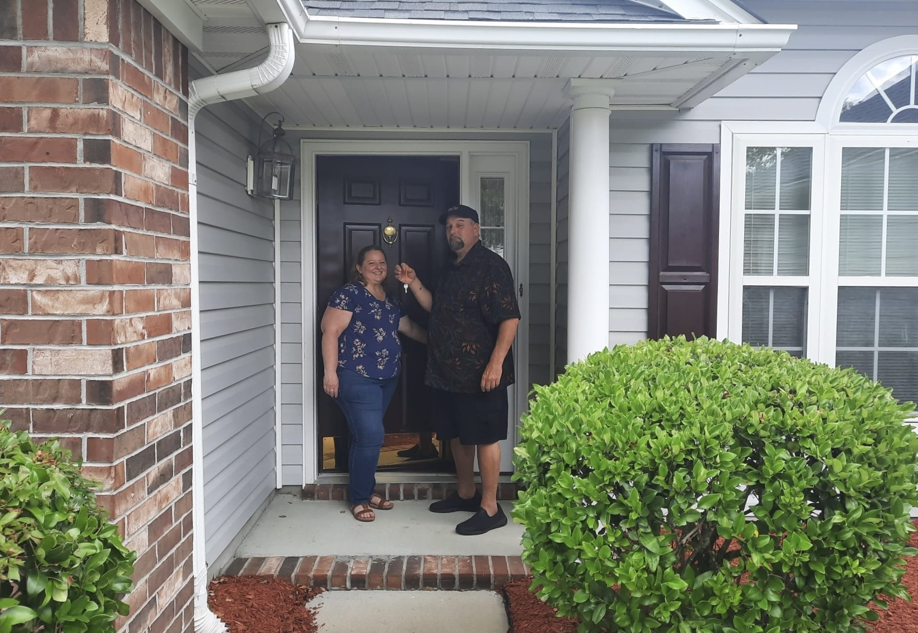 opening the door to their new home after using fairways certified pre-approval